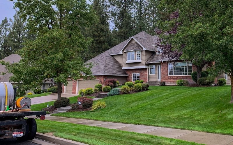 A beautiful residential home with lush and thick grass. The grass is green and weed free.