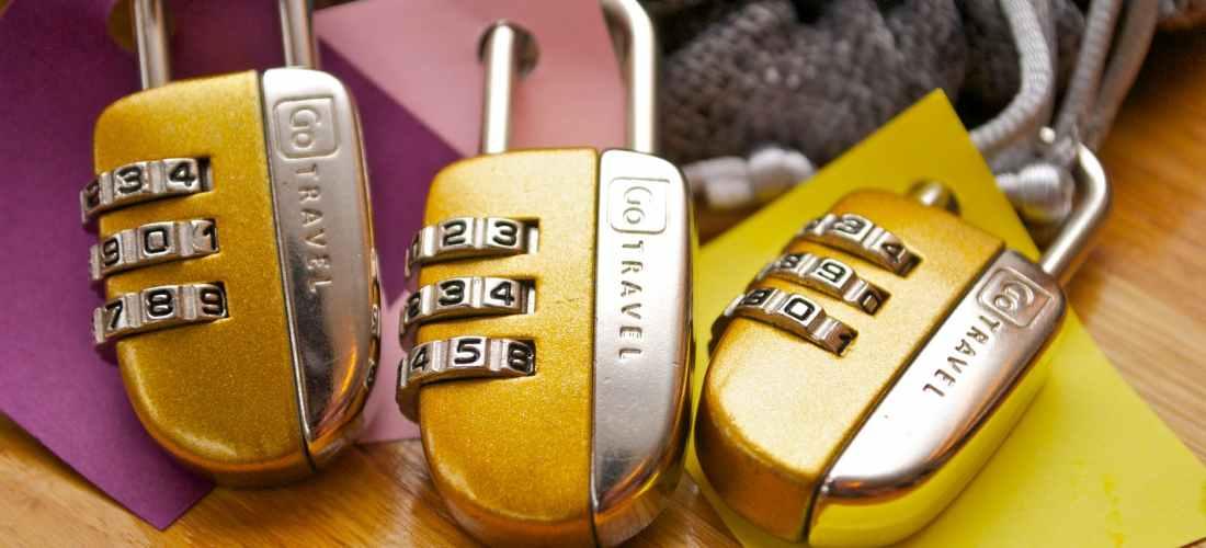three gold and silver combination padlocks