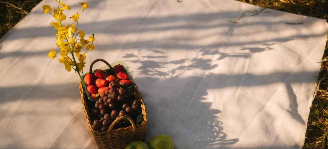 basket of fruit on white cloth