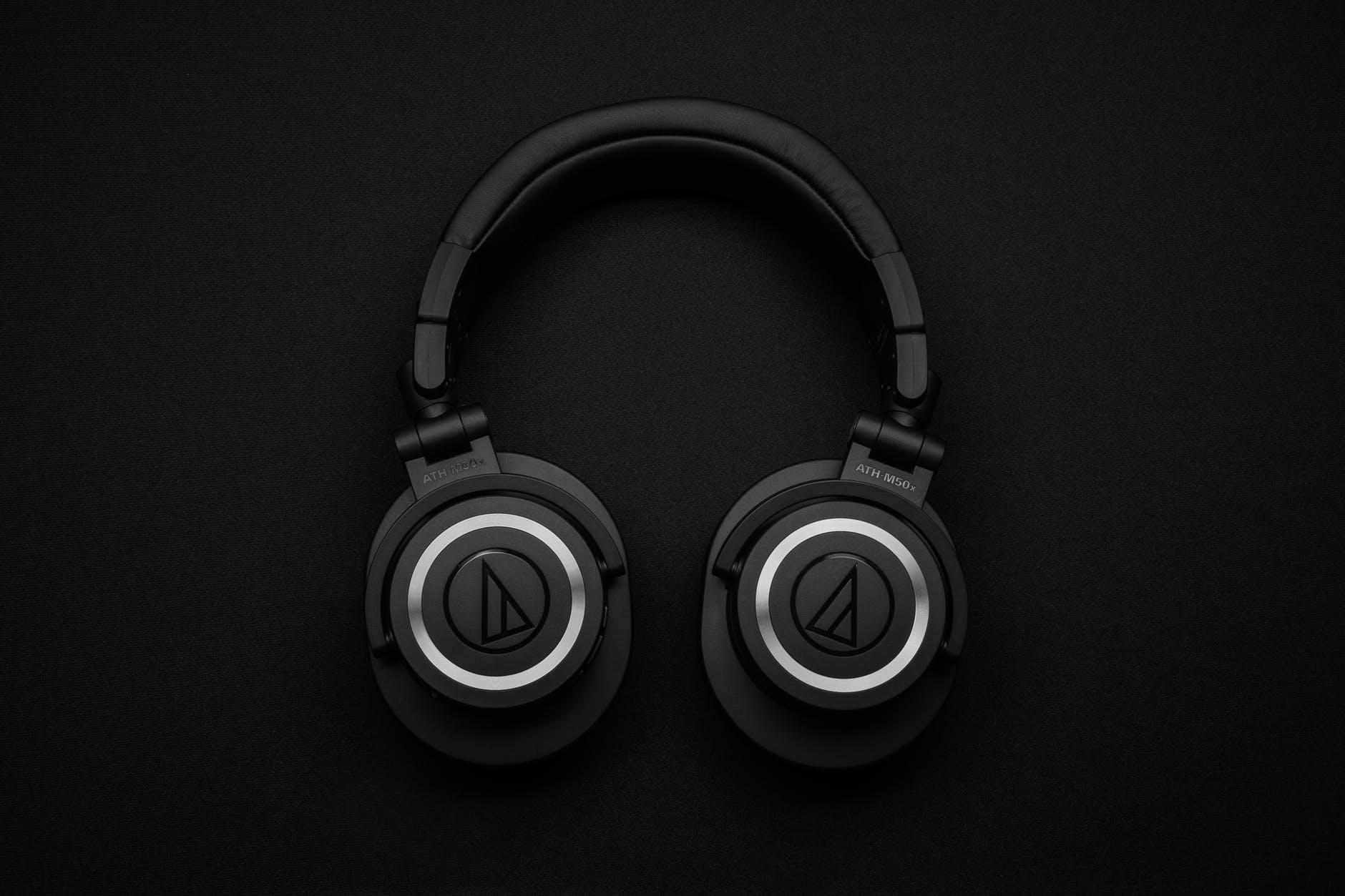 top view photo of black wireless headphones