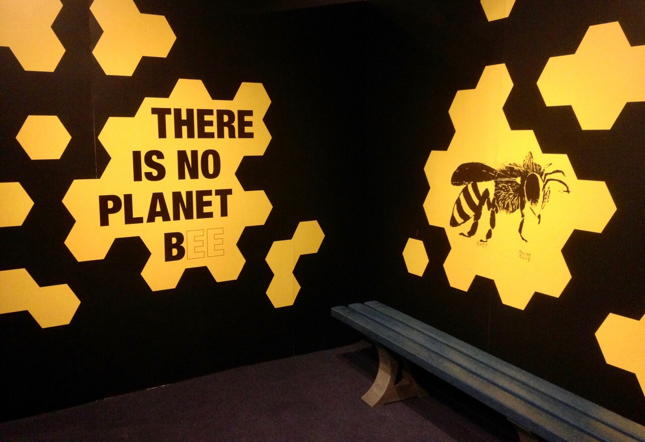 """""""There is no Planet Bee"""" reads this wall art, featuring honeycomb patterns of gold on black and, of course, the image of a bee"""