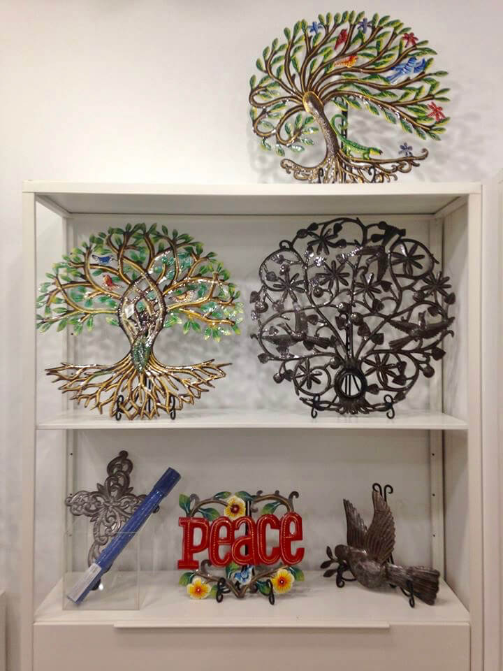 Pieces displayed at Ten Thousand Villages Waterloo in Feb. 2020, including tree designs made from oil drums by workers associated with Comité Artisanal Haïtien in Haiti