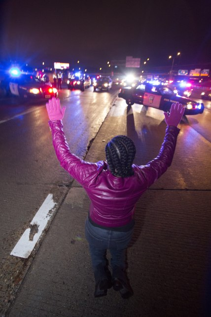NAACP-Mpls President Nekima Levy-Pounds and protesters