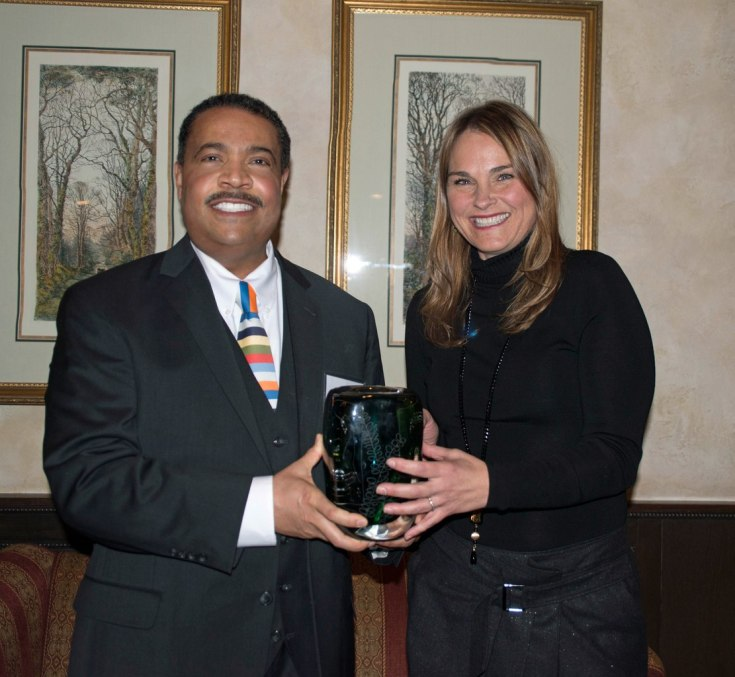 Dr. Charles Crutchfield III (l) receives his award from Dr. Carolyn McClain.