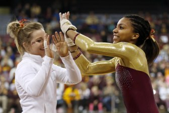 Ciara Gardner (r) high-fives a teammate after a strong performance.