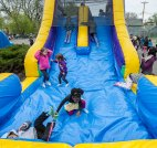 The event was family-friendly as kids enjoyed bounce houses and other activities