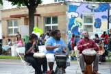 Crowds gathered to watch three drummers at the 11th Annual FLOW Northside Arts Crawl, July 30.