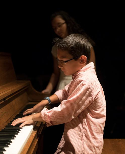 Jacob, a young musician with the TC Mobile Jazz Project shows off his skills after the press conference