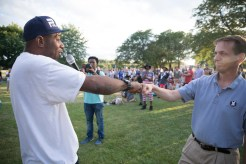 Falcon Heights Mayor Peter Lindstrom bumps fists with activist John Thompson, a friend of Philando Castile