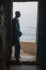 """Steve Floyd standing at the """"Door of No Return"""" on GoréeIsland"""