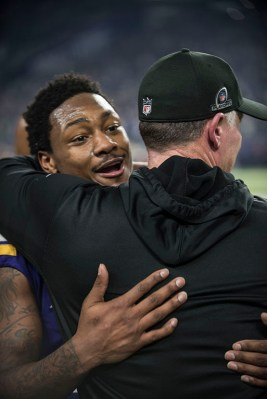 Coach Mike Zimmer hugs Stefon Diggs after his game-winning catch