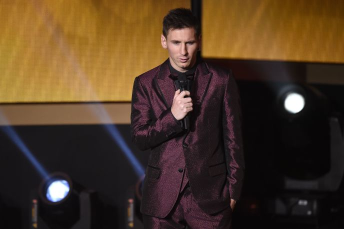 Barcelona and Argentina forward Lionel Messi speaks on stage during the 2014 FIFA Ballon d'Or award ceremony at the Kongresshaus in Zurich on January 12, 2015. AFP PHOTO / OLIVIER MORIN