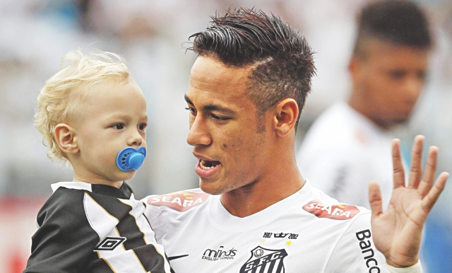 Neymar and his son David Lucca on the pitch