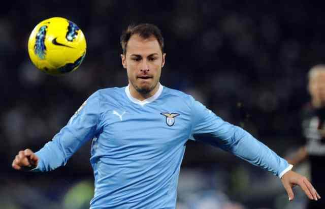 Lazio's Romanian defender Stefan Radu controls the ball during the Italian Serie A football match between Lazio vs Milan at the Olympic Stadium in Rome on February 1, 2012. AFP PHOTO / GABRIEL BOUYS