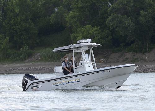 game wardens on boat patrol