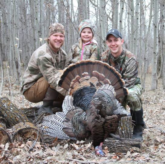 "Kali Knutsen with her first turkey!  7 years old, with the Cory Loeffler ""Guide service!"""