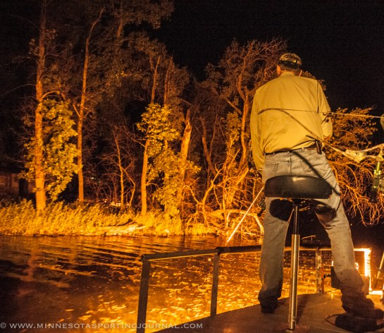 Curt Wells searches for carp at night