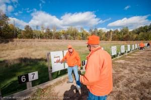 Fladland checks his target at the range.