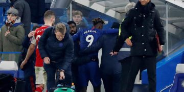 Chelsea's Tammy Abraham helped off the pitch after Arsenal draw