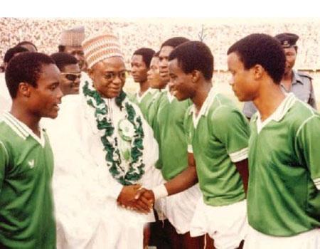 Flying Eagles 1983 captain Ali Jeje, introducing Paul Okoku to former President Shehu Shagari