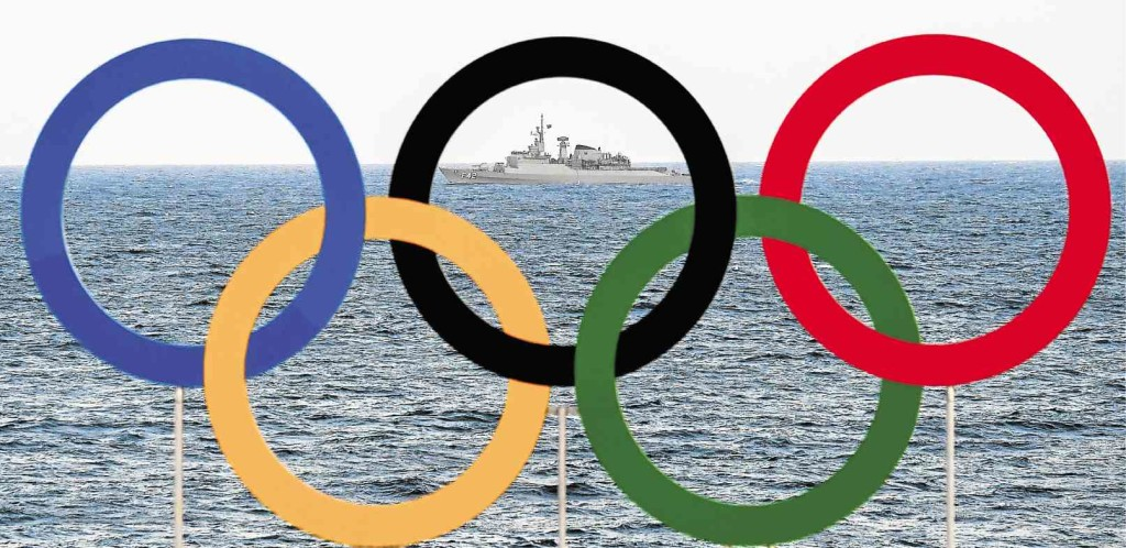 LET THE GAMES BEGIN  A boat of the Navy of Brazil is pictured with the interlocking Olympic Rings colored blue, yellow, black, green and red as it patrols the coast of Copacabana beach in Rio de Janeiro, a day ahead of the Rio 2016 Olympic Games. AFP