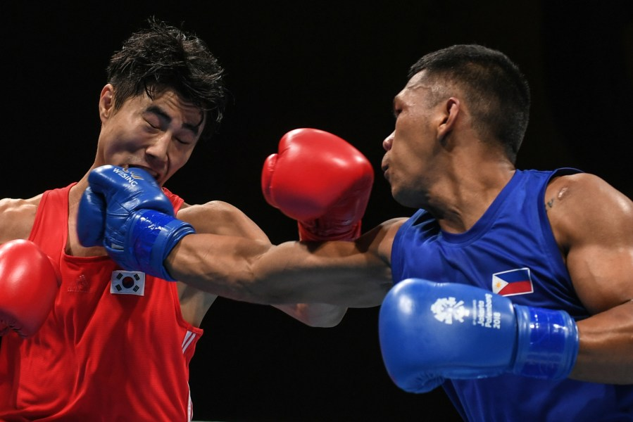 Marcial assured of bronze in Asian Games boxing   Inquirer Sports     Philippines  Eumir Felix Marcial  blue  in their men s middle  75kg   quarter final boxing match at the 2018 Asian Games in Jakarta on August 29   2018