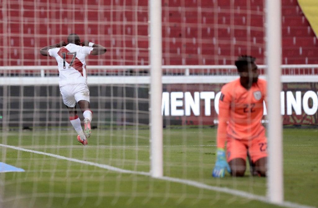 Peru's Luis Advincula (L) celebrates after scoring against Ecuador during their South American