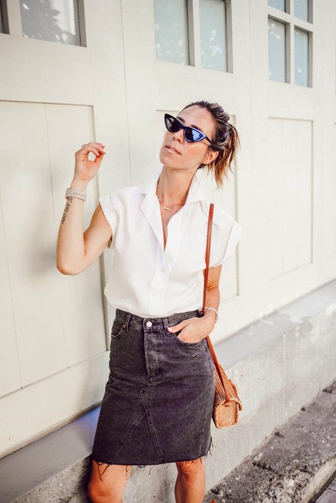 Seattle Fashion Blogger Sportsanista wearing white button blouse and black denim skirt