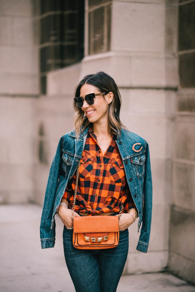 Blogger Mary krosnjar wearing Levis Chicago Bears Denim jacket and plaid flannel