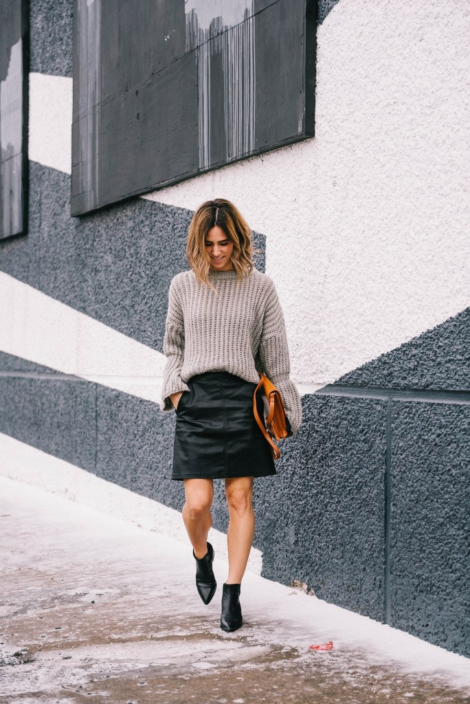 Blogger Mary Krosnjar wearing faux leather skirt and marc fisher booties
