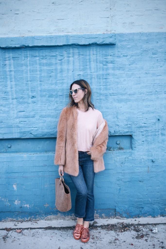 Blogger Mary Krosnjar wearing Ann Taylor Faux Fur Jacket with cropped denim