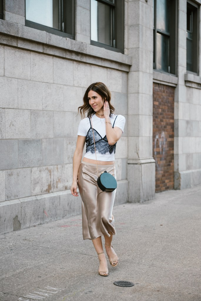 Blogger Mary Krosnjar wearing lace overlay cami top and Vince Silk Skirt