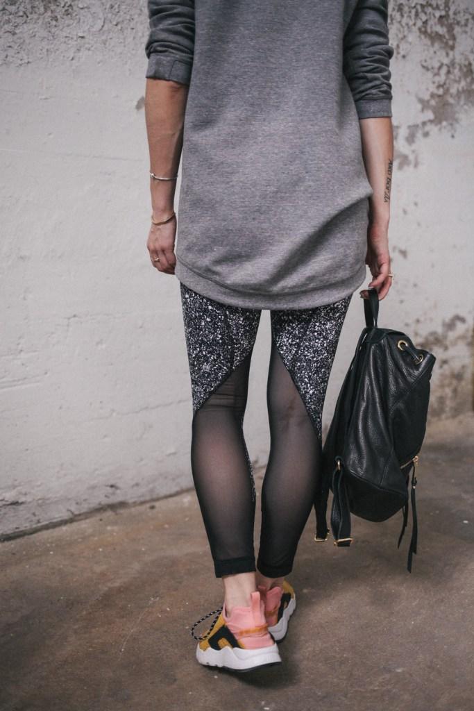 Blogger Mary Krosnjar wearing Lululemon pants and Linea Pelle Dylan Backpack