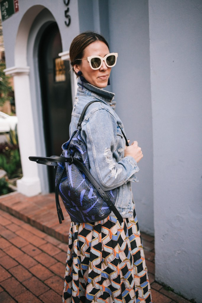 Blogger Mary Krosnjar wearing B.P. mirrored sunglasses and Opening Ceremony Palm Print Backpack
