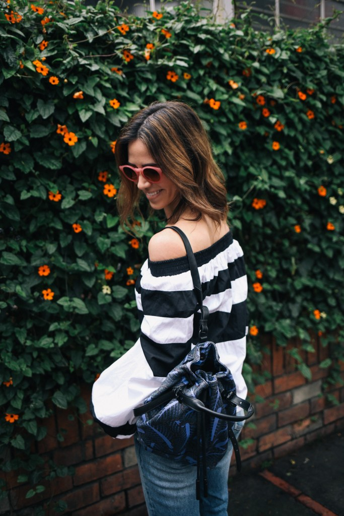 Blogger Mary Krosnjar wearing MLM Label Off the Shoulder Top and Opening Ceremony Printed Backpack