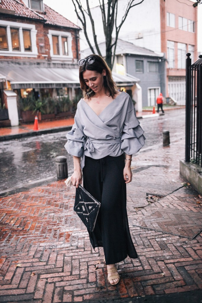 Blogger Mary Krosnjar wearing ruffled sleeved top and Bailey 44 cropped pants