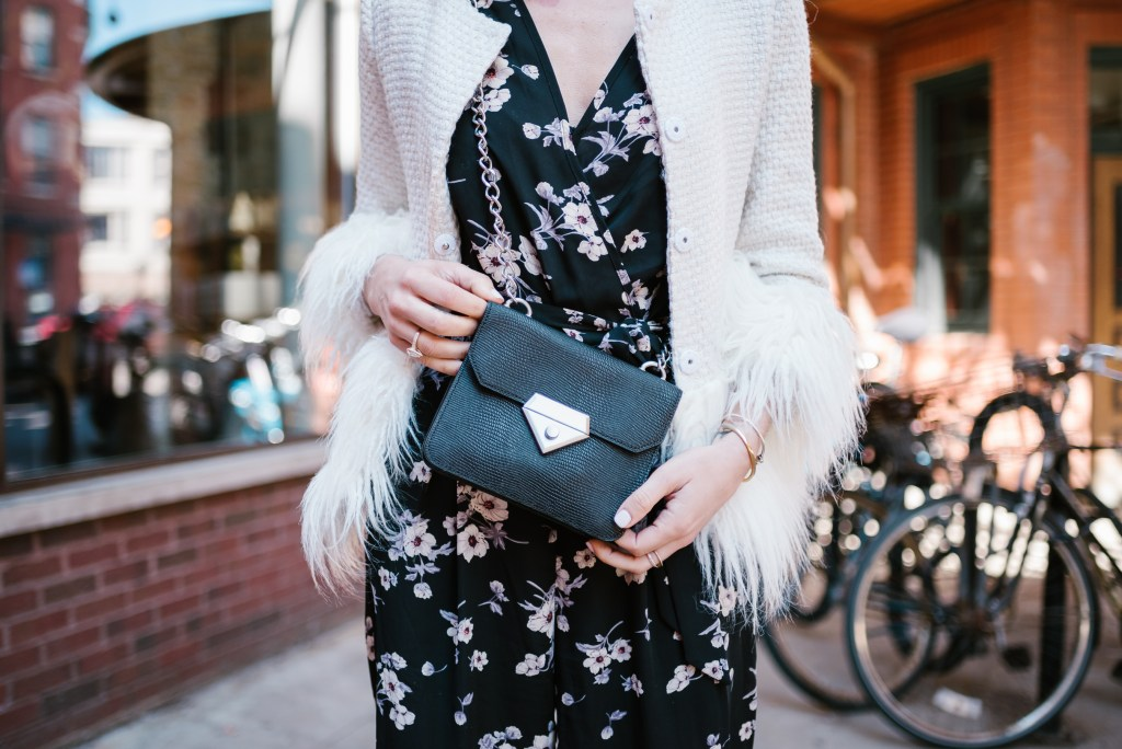 Blogger Mary Krosnjar wearing Linea Pelle Black Crossbody and white blazer with faux fur trim