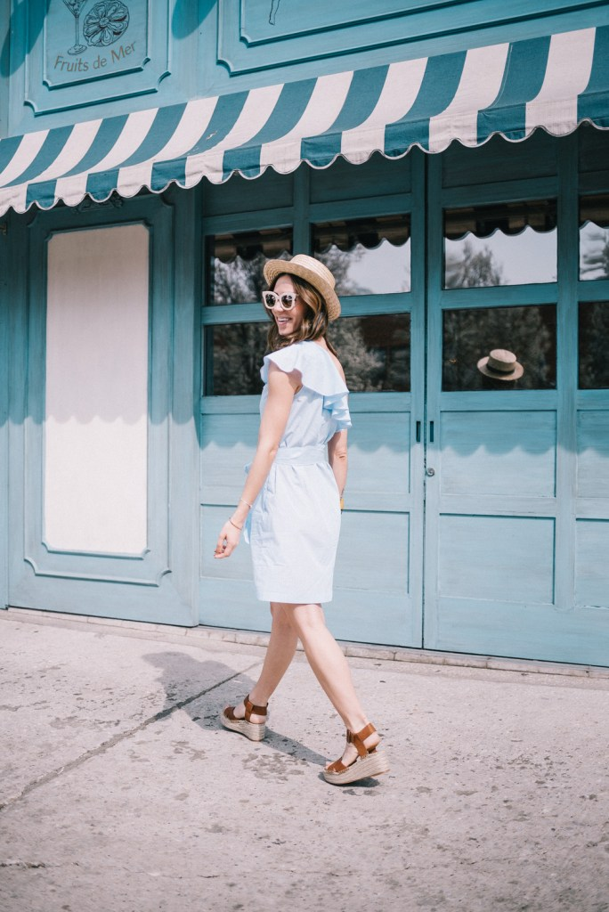 Blogger Mary Krosnjar wearing Donna Morgan One Shoulder Mini Dress with Belt at Maudes Liquor Bar