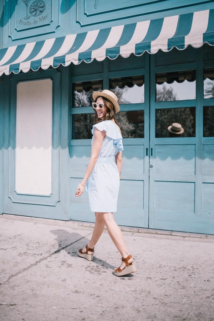 Blogger Mary Krosnjar wearing Donna Morgan One Shoulder Mini Dress with Belt at Maudes Liquor Bar