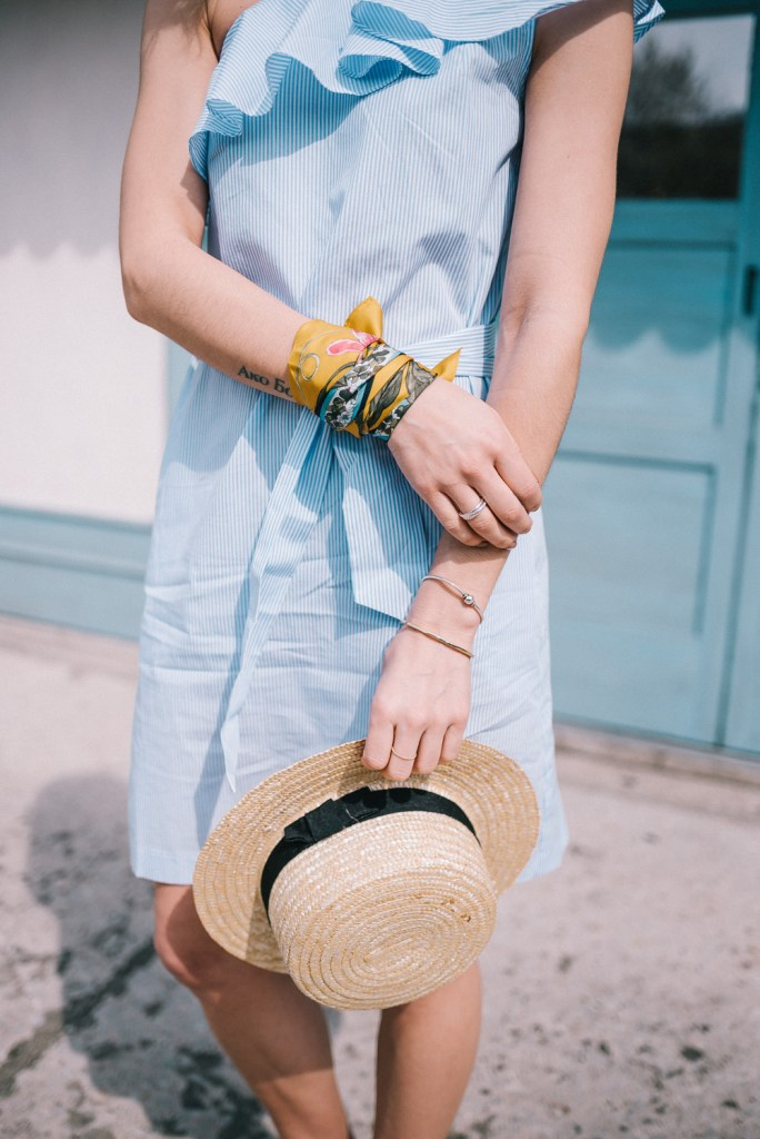Blogger Mary Krosnjar wearing Ann Taylor silk scarf and sole society straw hat