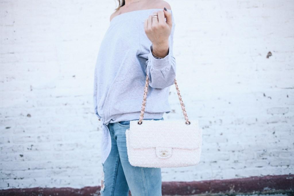 Blogger Mary Krosnjar wearing tweed Chanel bag and Ily Off the Shoulder Tie Sweatshirt