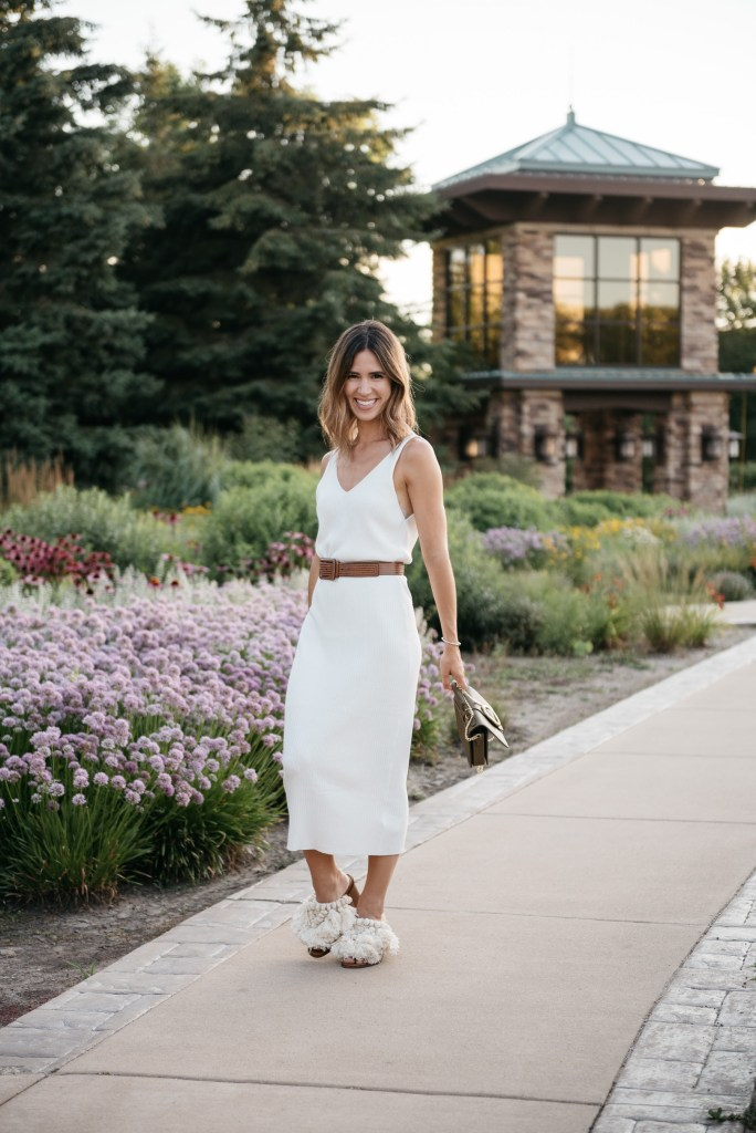 Blogger Mary Krosnjar wearing fringe open toe mules and cream knit dress