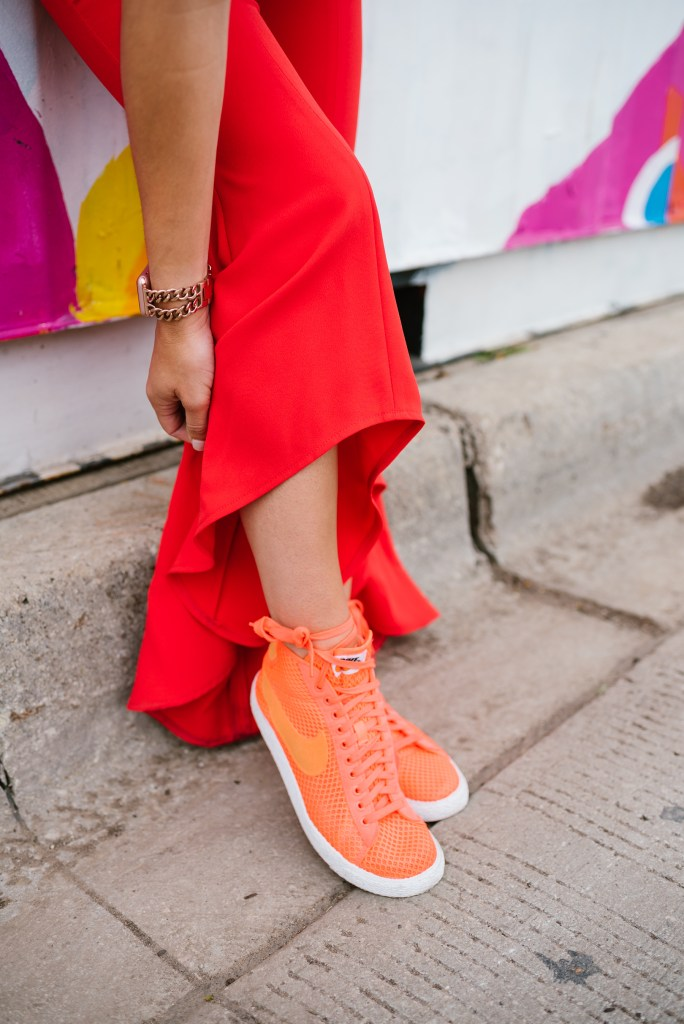 Blogger Mary Krosnjar wearing Gabrielle Ruffle Pant Jumpsuit and Nike Mesh Mid Blazer sneaker