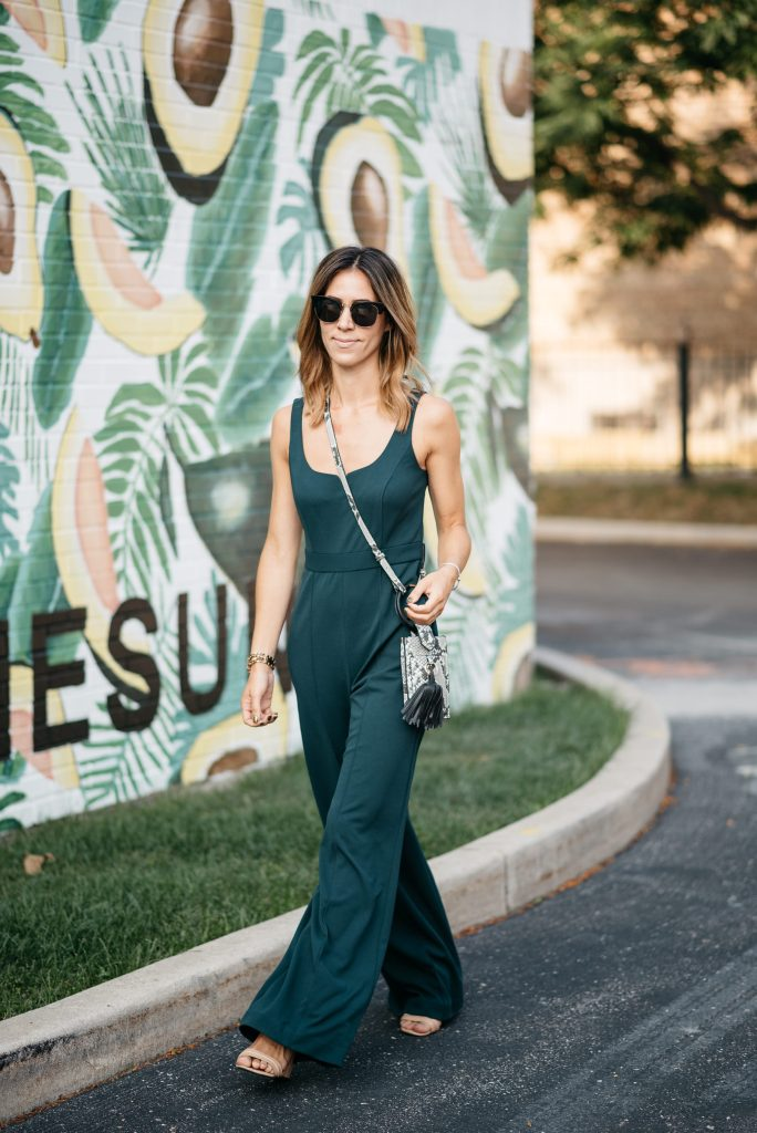 Blogger Mary Krosnjar wearing Donna Morgan Sweetheart Neck Jumpsuit at the Avocado wall in Chicago