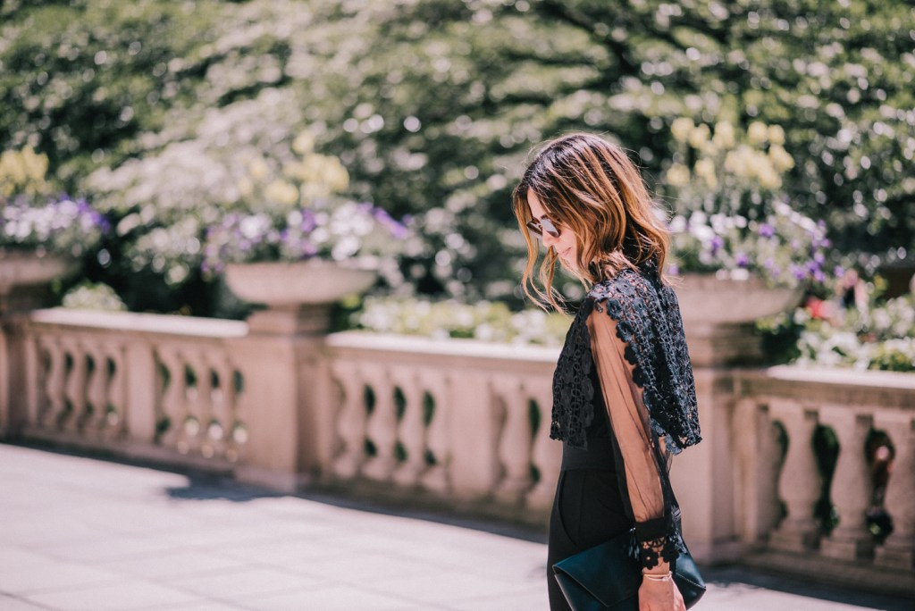 Blogger Mary Krosnjar wearing Black and Lace jumpsuit under $50