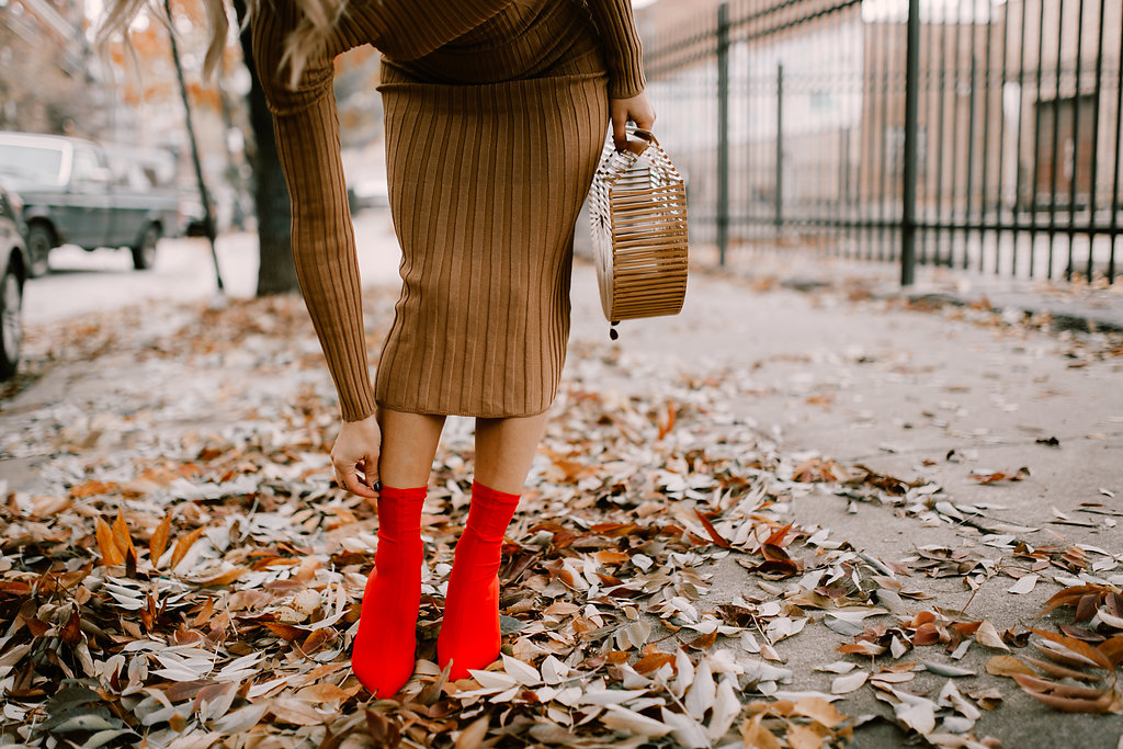 Blogger Mary Krosnjar wearing Red Ankle Booties, Tan Knit Dress and Bamboo Bag