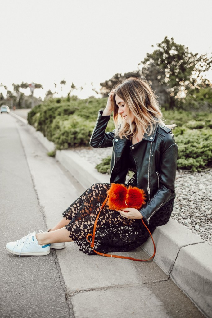 Blogger Mary Krosnjar wearing ASTR Lace Midi Dress and Elaine Faux Fur Clutch