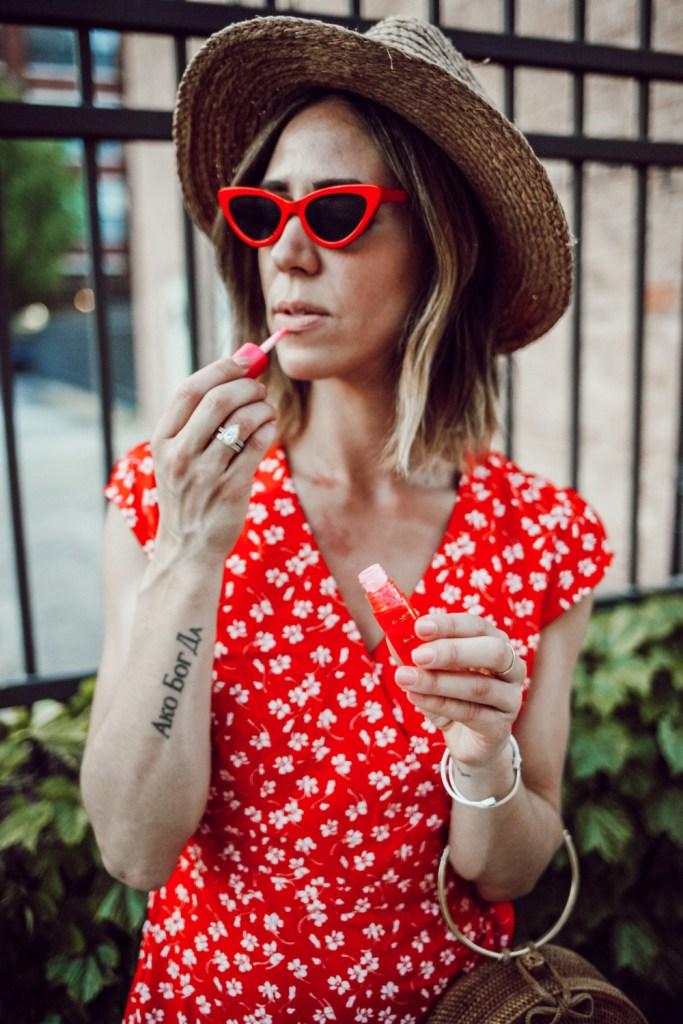 Blogger Mary Krosnjar wearing J.Crew wrap dress and red cat eye sunglasses