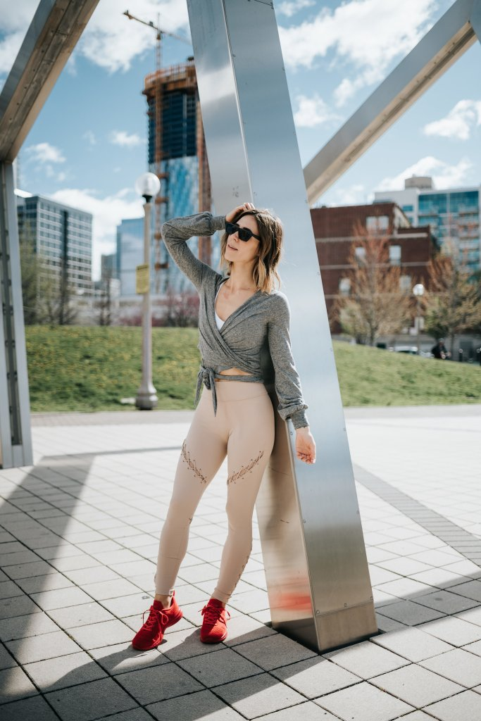 Blogger Mary Krosnjar wearing APL sneakers and Ballet wrap long sleeve top