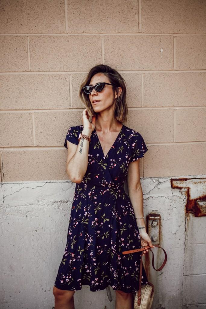 Blogger Mary Krosnjar wearing Ann Taylor Floral Ruffle Wrap Dress and Cay Eye Sunglasses